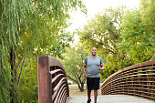 Mature African American man walking in the park.