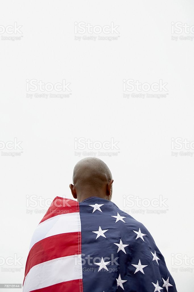 African american man wearing an american flag royalty-free stock photo