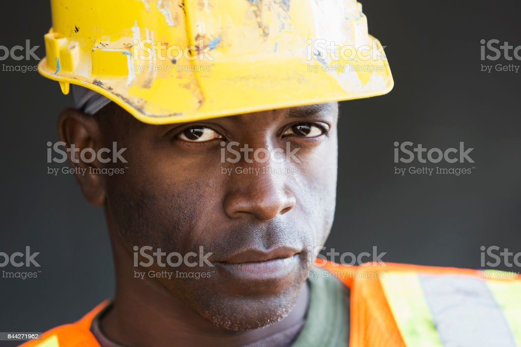 African American man wearing hardhat and safety vest stock photo