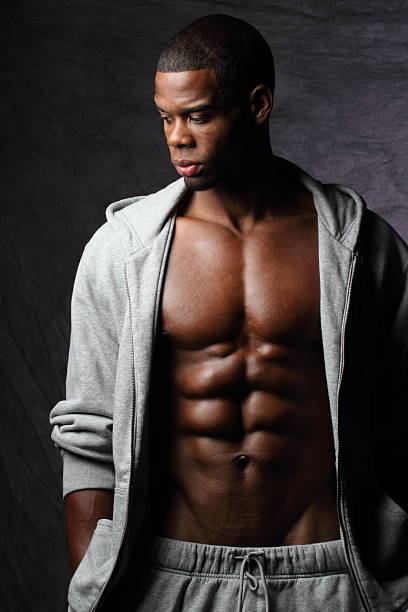 African American Man With Abs Looks Down Right stock photo