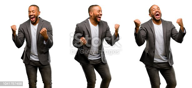 925466128istockphoto African american man with beard happy and excited celebrating victory expressing big success, power, energy and positive emotions. Celebrates new job joyful 1041757458