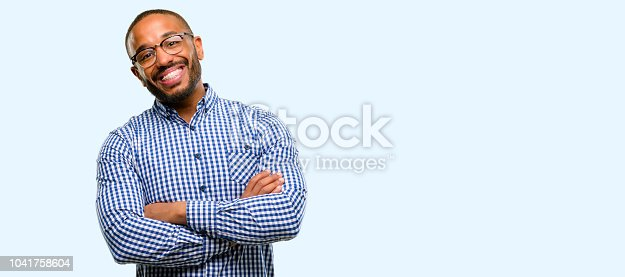 istock African american man with beard with crossed arms confident and happy with a big natural smile laughing 1041758604