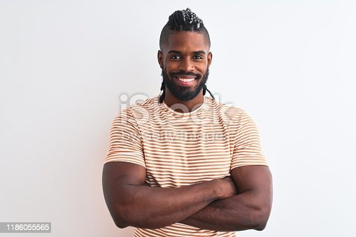613542420 istock photo African american man with braids wearing striped t-shirt over isolated white background happy face smiling with crossed arms looking at the camera. Positive person. 1186055565