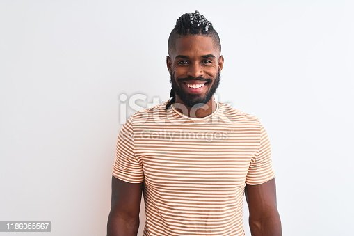 613542420 istock photo African american man with braids wearing striped t-shirt over isolated white background with a happy and cool smile on face. Lucky person. 1186055567