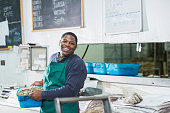 istock African American man working in fish market 638565344