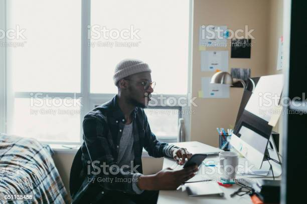 African american man working in his bedroom office picture id651138488?b=1&k=6&m=651138488&s=612x612&h=tc742frskraufahhua5hdfb8u umgovi9c8jimumjwi=