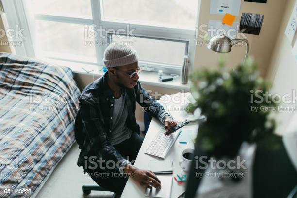 African american man working in his bedroom office picture id651143222?b=1&k=6&m=651143222&s=612x612&h=gq3dlcyhlak7ii cvl80rm1girdugua5nm8a3xww8a0=