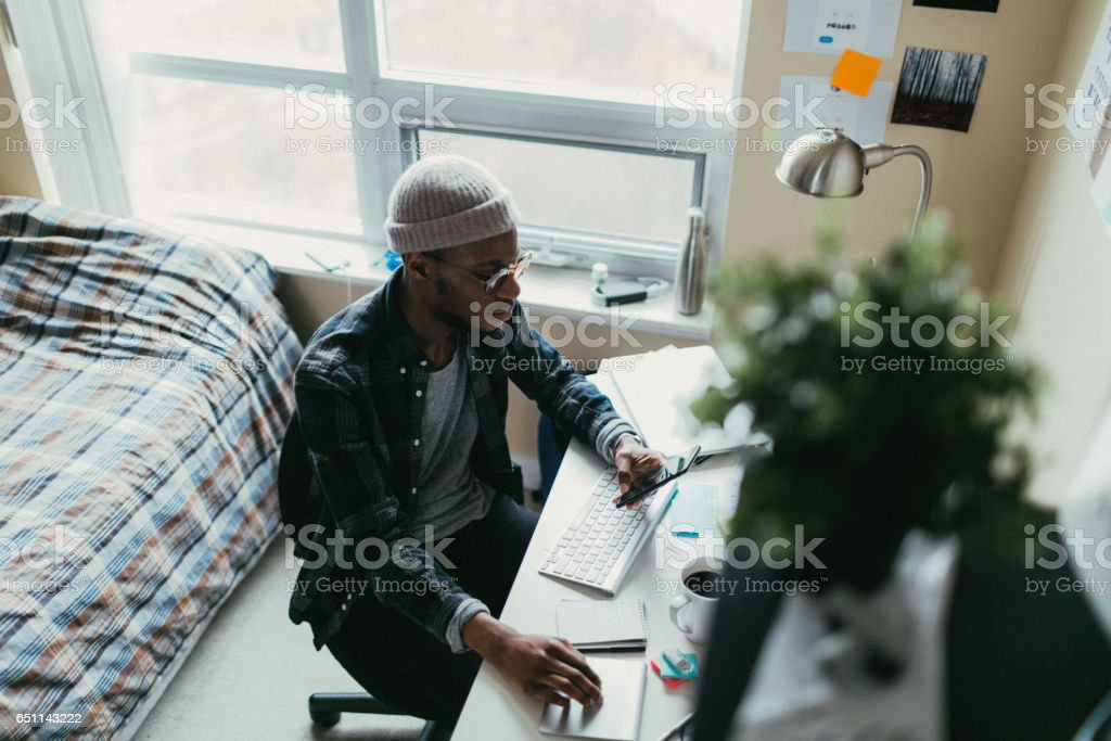African american man working in his bedroom office stock photo