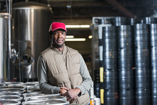 istock African American man working in microbrewery 476647288