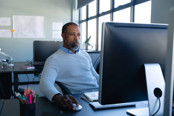 African American man working in office stock photo