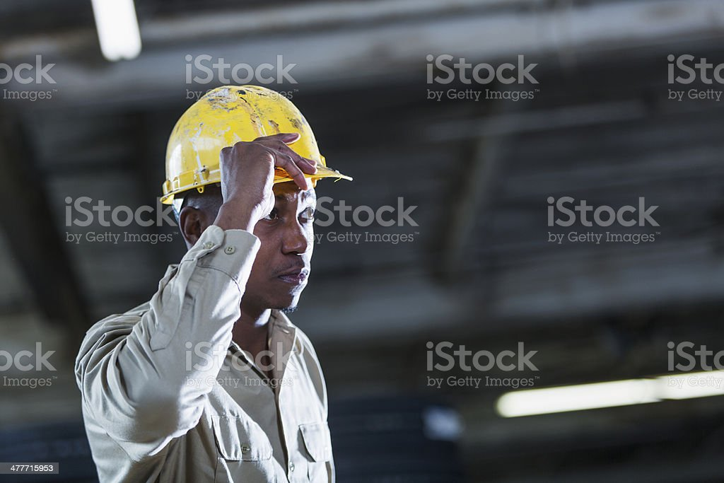 African American man working in warehouse stock photo
