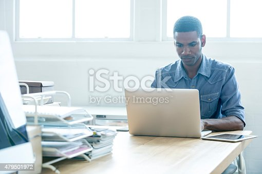 872006502 istock photo African American man working on a laptop computer. 479501972