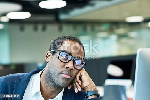 istock African American manager looking at screen 623692422