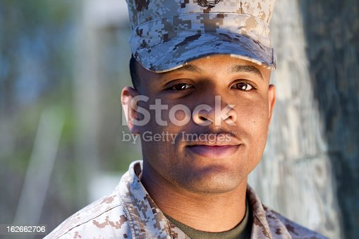 African American Marine with a warm tone to the image. This was shot with a gold reflector to his right.