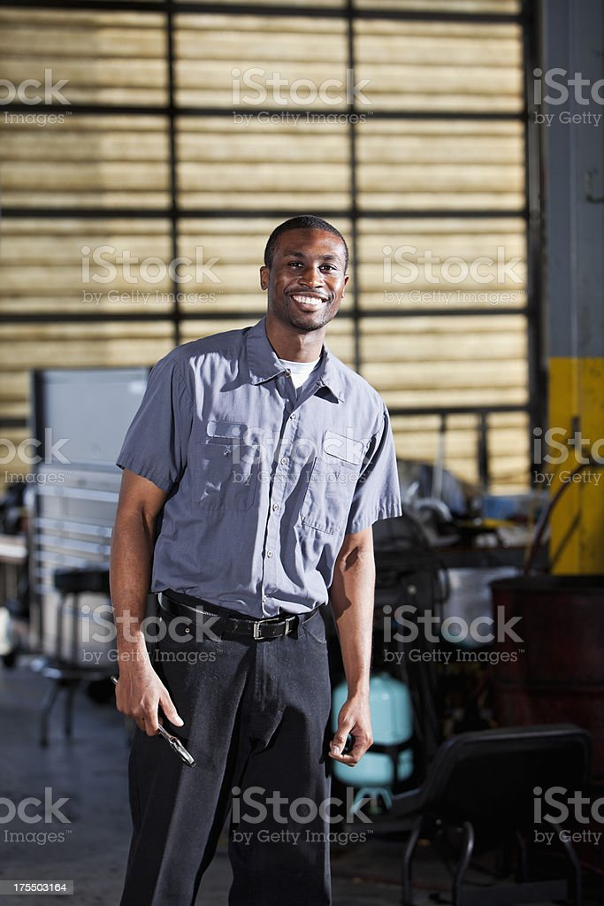 African American mechanic in garage stock photo