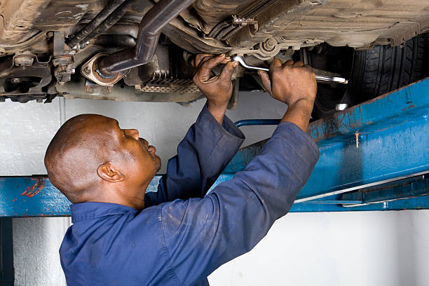 african american mechanic working on a vehicle stock photo