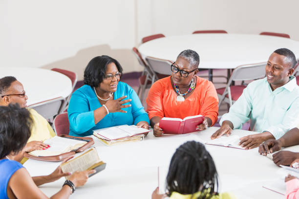 African American men and women at bible study meeting stock photo