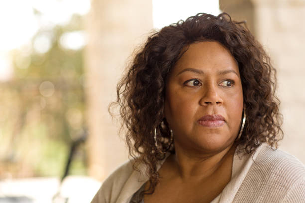 African American middle age woman looking sad. stock photo