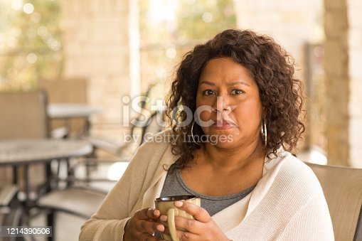 Middle age woman in deep thought