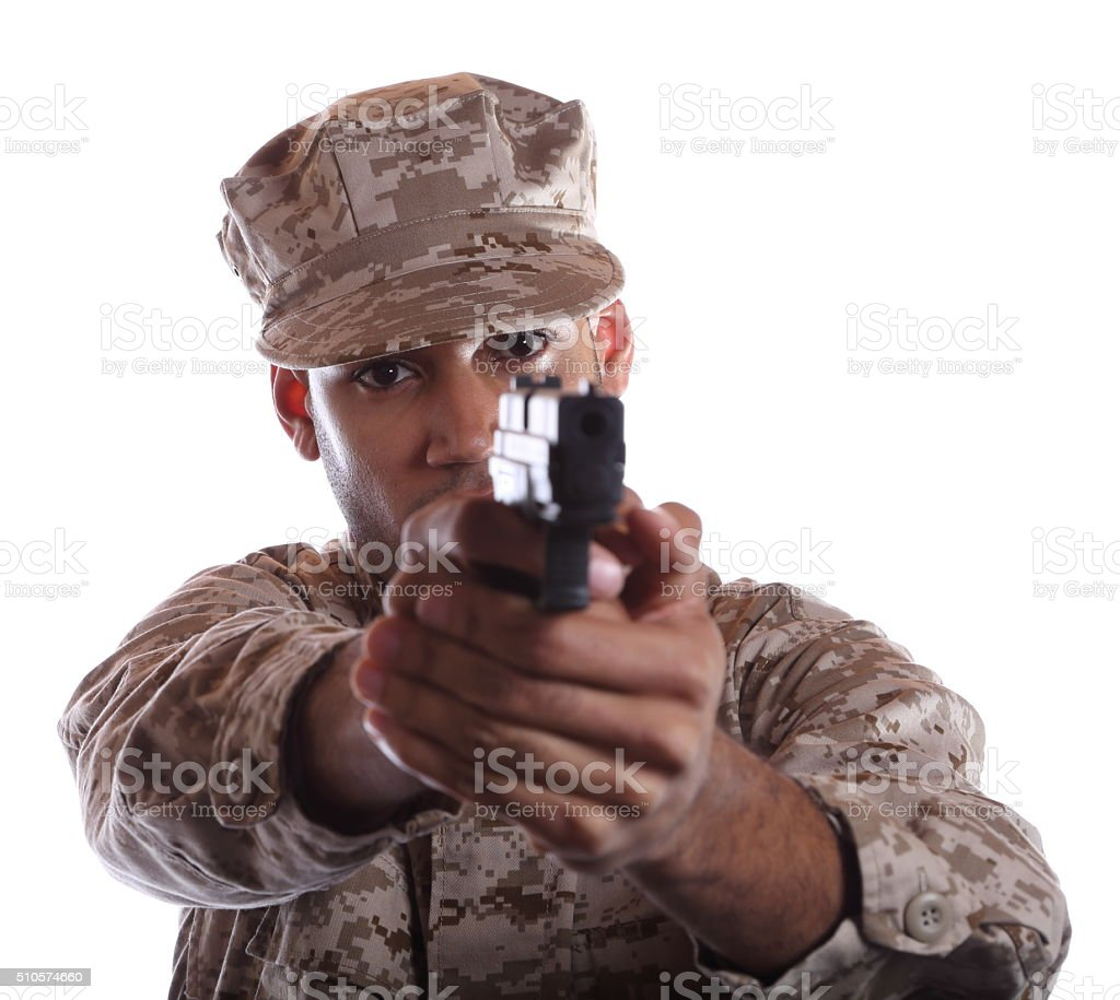 African American Military Man Aims Weapon stock photo