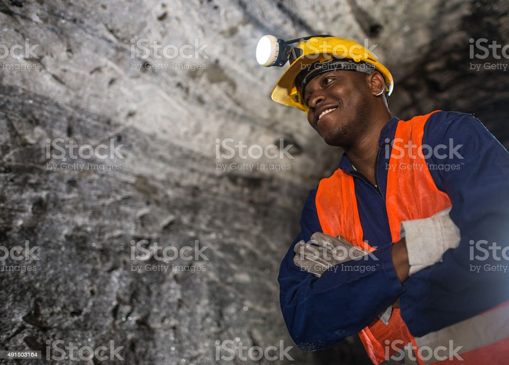 African American miner working at the mine stock photo