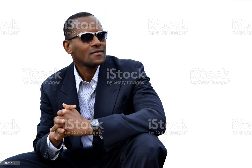 African American Model in a business suit Kneeling; White Background stock photo