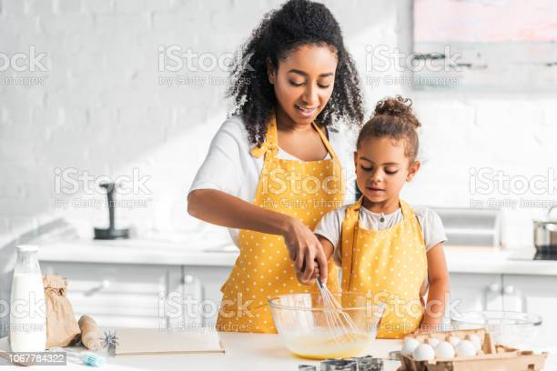 African american mother and daughter preparing dough and whisking in picture id1067784322?b=1&k=6&m=1067784322&s=612x612&h=cejvfhtt9cjz3tn8hjzhprikdefyxy5sub9vfizifbw=