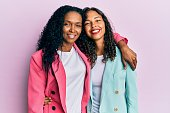 istock African american mother and daughter wearing business style with a happy and cool smile on face. lucky person. 1288615092