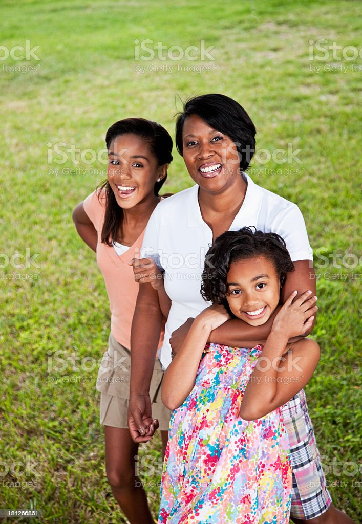 African American mother and daughters outdoors stock photo