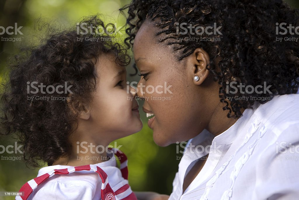 African American mother and her biracial child rubbing noses stock photo
