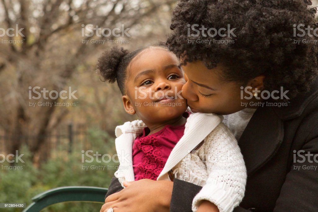 African American mother and her daugher. Happy African American mother and her daughter. 30-39 Years Stock Photo