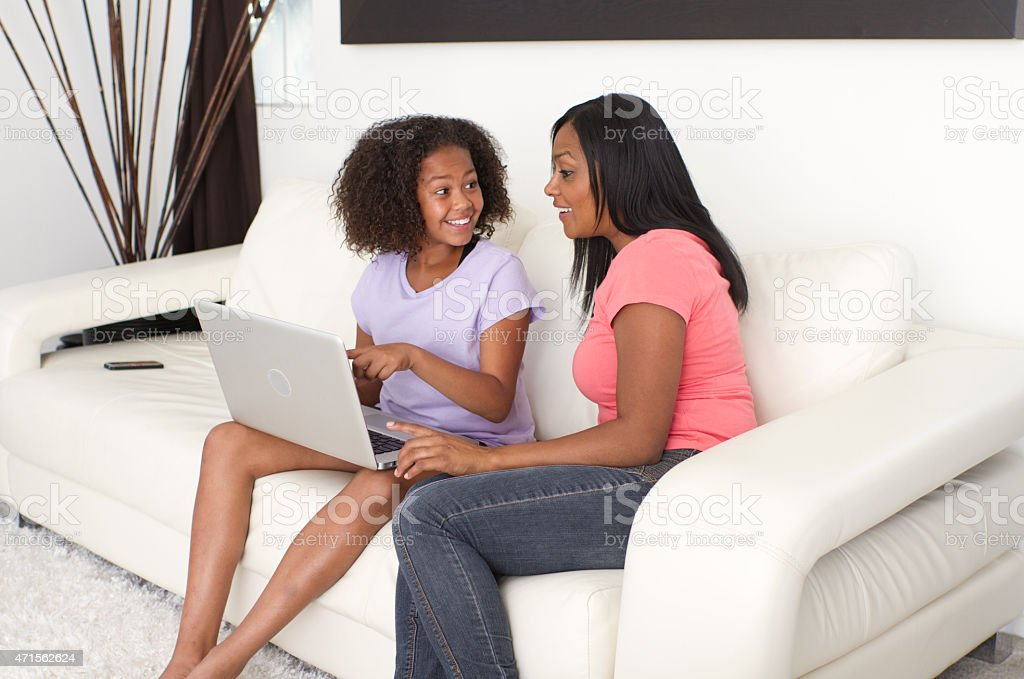 African American Mother Daughter Shop Online With Laptop Computer Horizontal stock photo