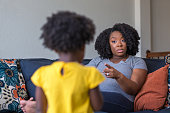 istock African American mother disciplining parenting her young child. 1189667681