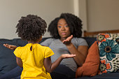 istock African American mother disciplining parenting her young child. 1196050850