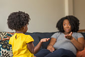 istock African American mother disciplining parenting her young child. 1204523445