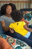 istock African American mother playing and talking with her daughter. 1198952994