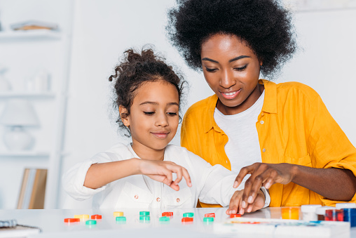 istock african american mother teaching daughter numbers at home 927881070