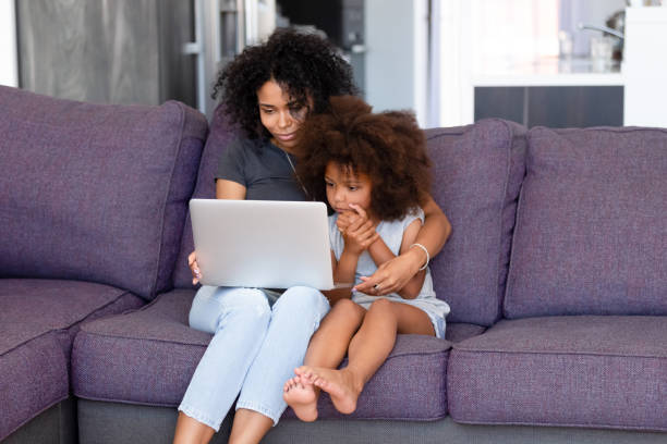 African american mother with little daughter using laptop together picture id1137632776?b=1&k=6&m=1137632776&s=612x612&w=0&h=2xho3snymieqidqsq0vbdhsnh0nyatz613idmilhwsg=