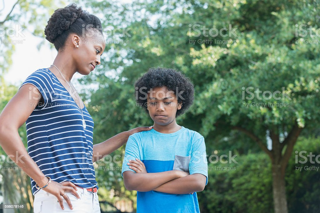 African American mother with mixed race son, parenting stock photo
