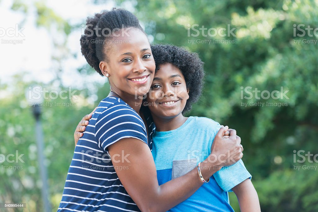 African American mother with mixed race son stock photo