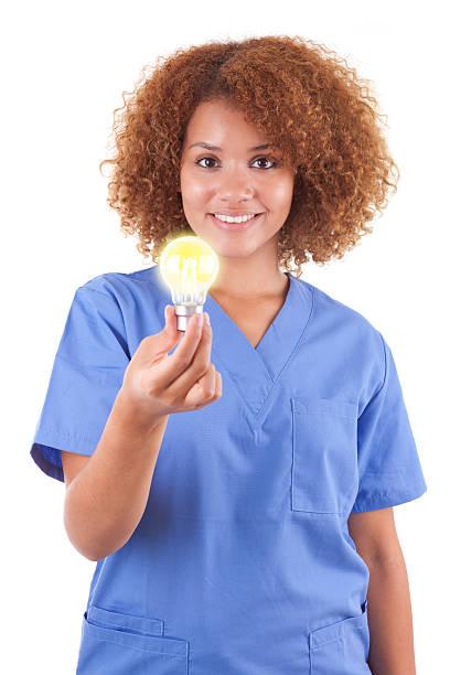 African American nurse holding a light bulb - Black people stock photo