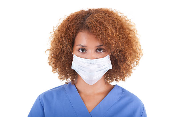 African American nurse holding a mask -  Black people stock photo