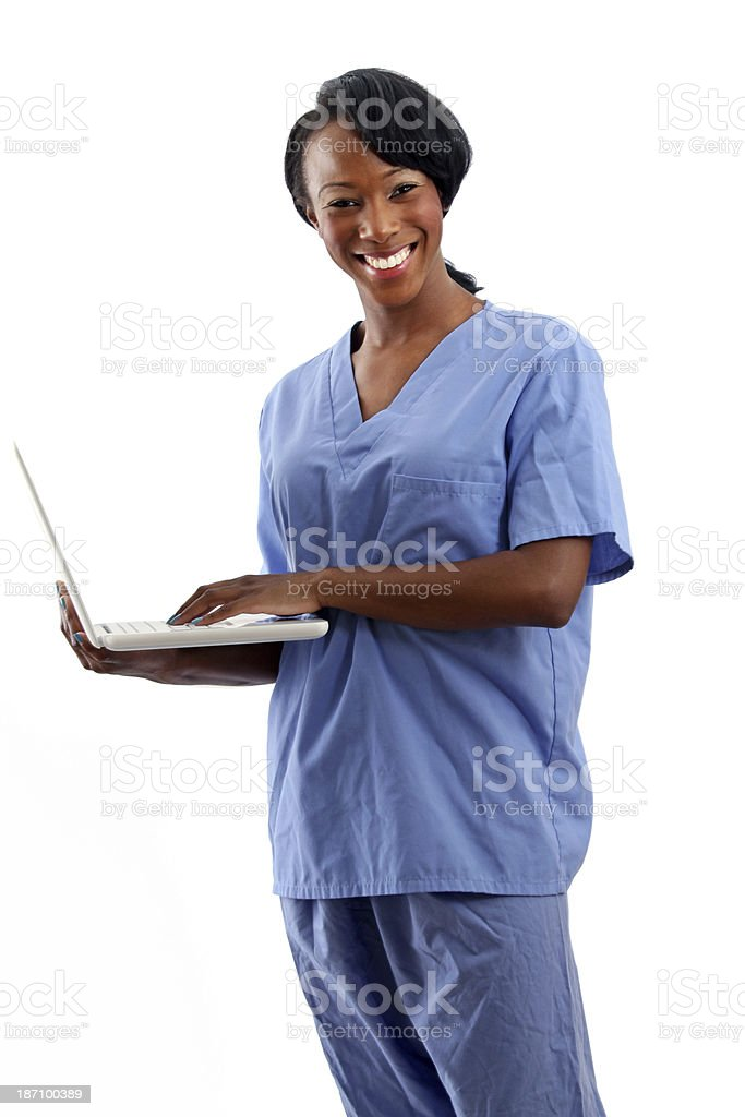 African American Nurse smiling with laptop stock photo