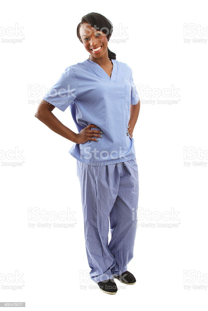 African american nurse with hands on hips - full body stock photo