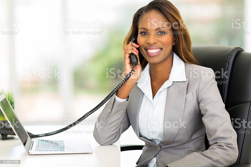 african american office worker talking on the phone stock photo