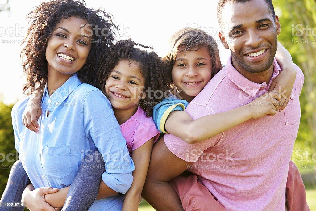 African American Parents Giving Children Piggyback Rides stock photo