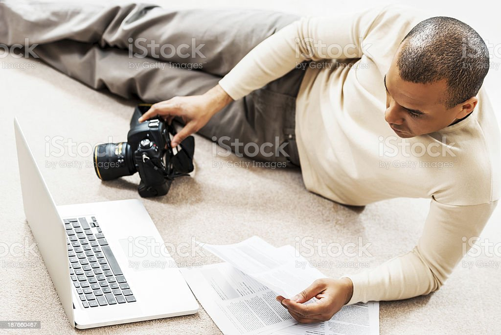 African American photographer working at home. royalty-free stock photo