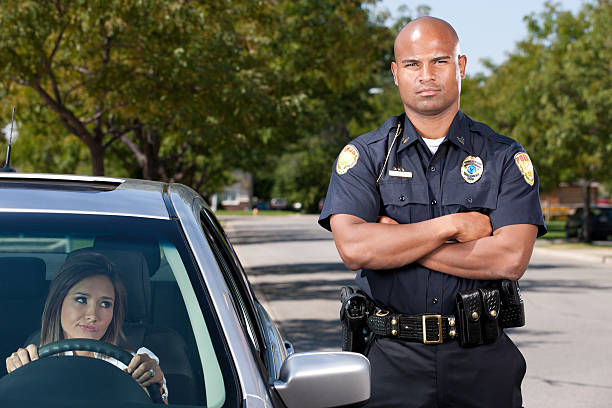 African American Police Officer Making Traffic Stop stock photo