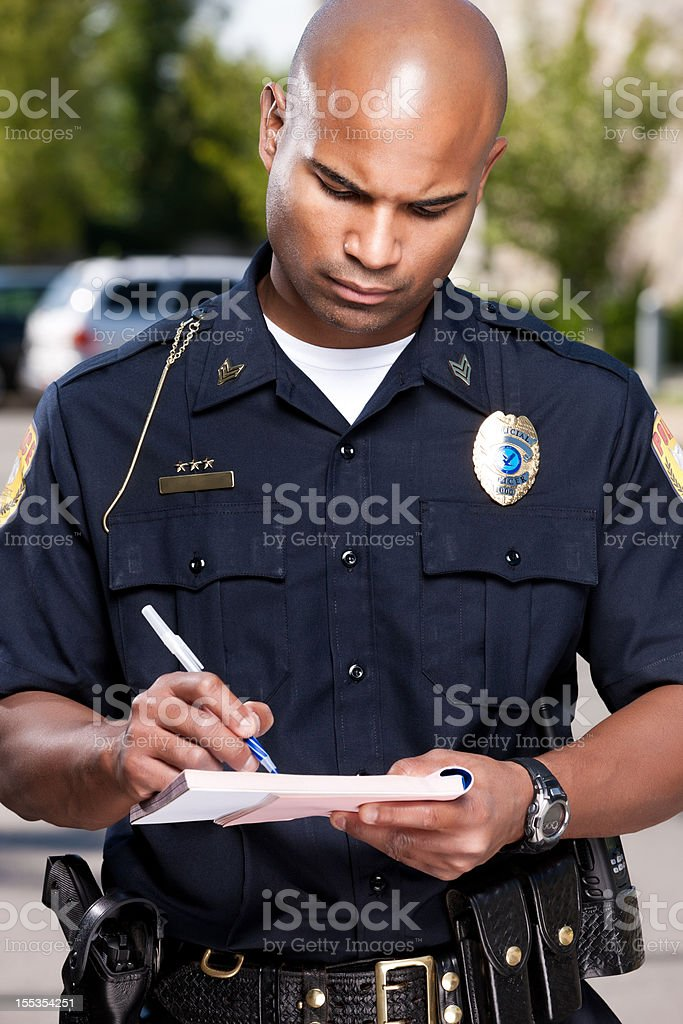 African American Police Officer Writing a Ticket stock photo