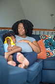 istock African American pregnant mother and her daughter. 1196050990